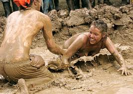 Glastonbury festival-goers covered in mud