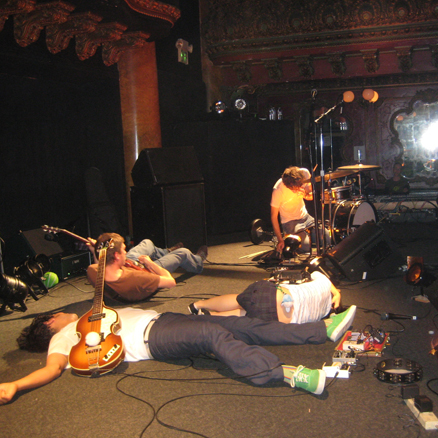 Deerhoof on stage by Mcgwireonfire via Wikipedia