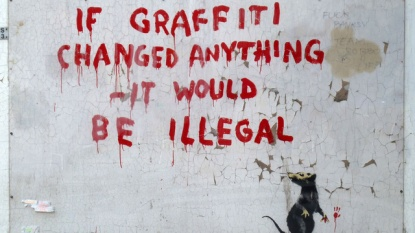 Banksy graffiti image from Jezebel